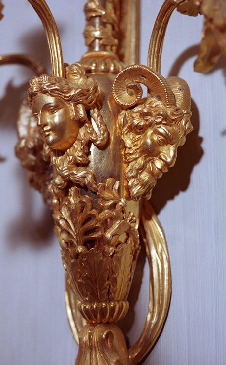 Pair of large Louis XVI three light ormolu sconces attributed to François Rémond