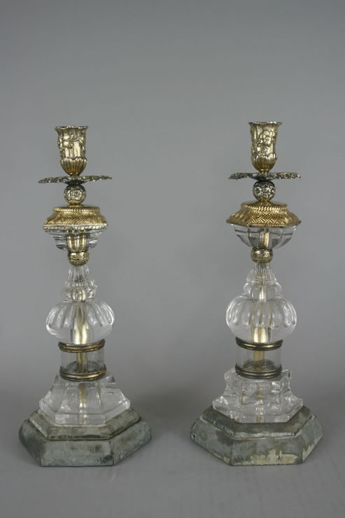 Baroque style rock crystal and vermeil candlesticks