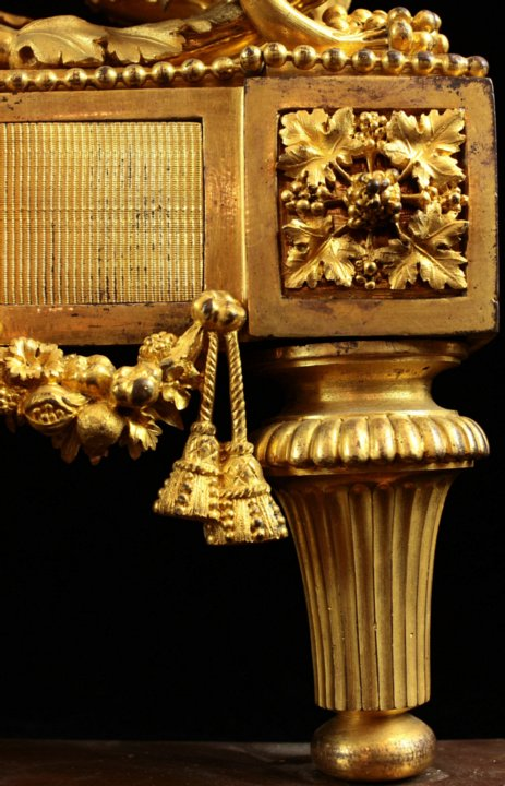Pair Louis XVI ormoulu chenets with original gilding