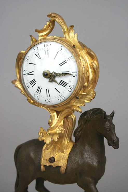 Early Louis XV clock supported by a horse.