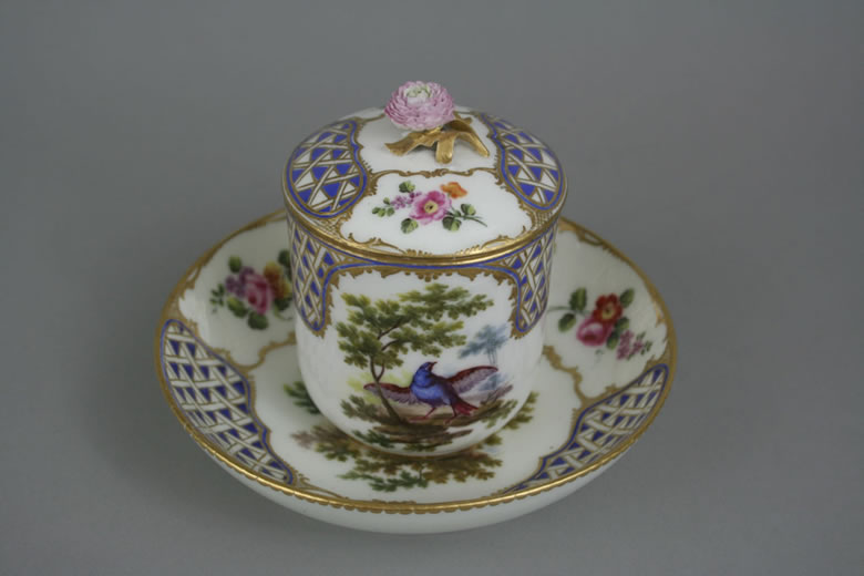 Sevres covered cup and saucer