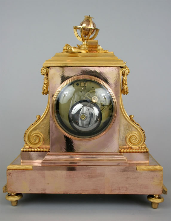 Louis XVI clock by Revel with exceptional two-colored gilding