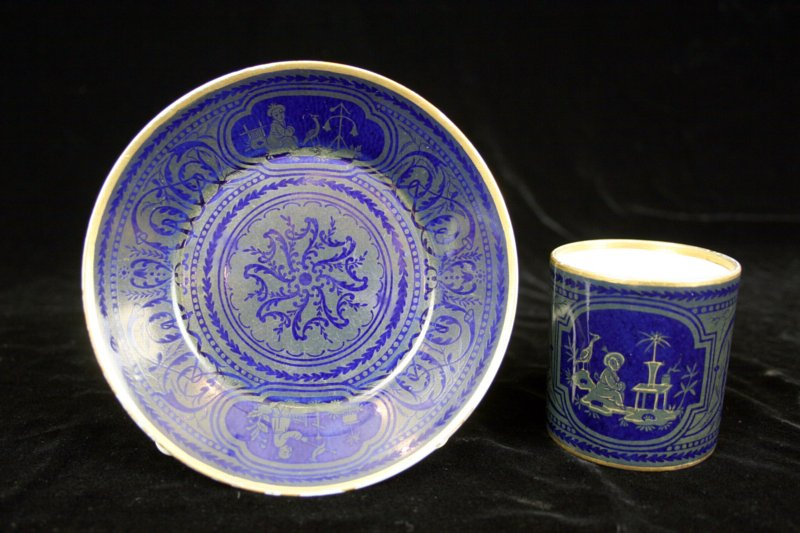 Sèvres chinoiserie and arabesque decorated coffee can and saucer (goblet litron et soucoupe.)