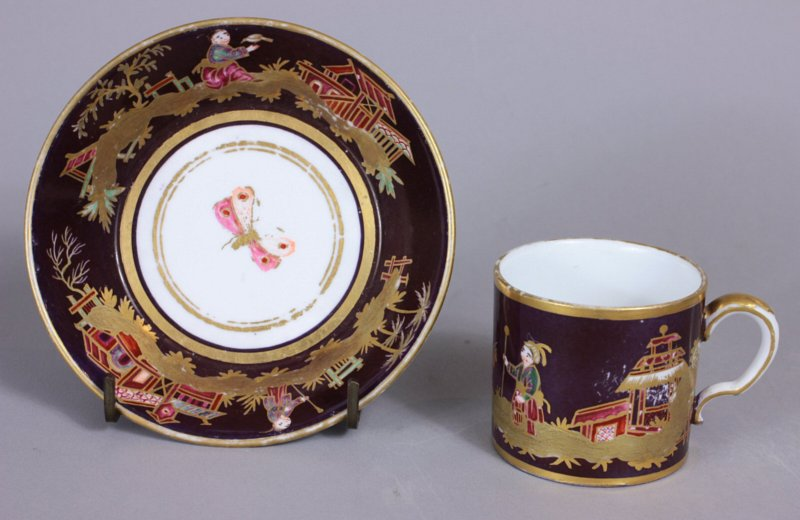Small Sevres Chinoiserie purple ground cup and saucer