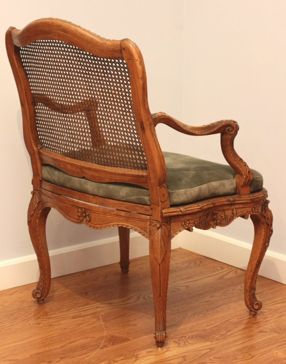 Set of four superb Régence caned fauteuils