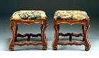 Pair of os de mouton Louis XIV walnut tabourets covered with old needlepoint