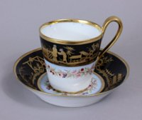Sevres Empire black ground Chinoiserie cup and saucer